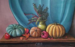 Still life with pumpkins and barberry.