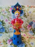 Doll in Russian style with a samovar.